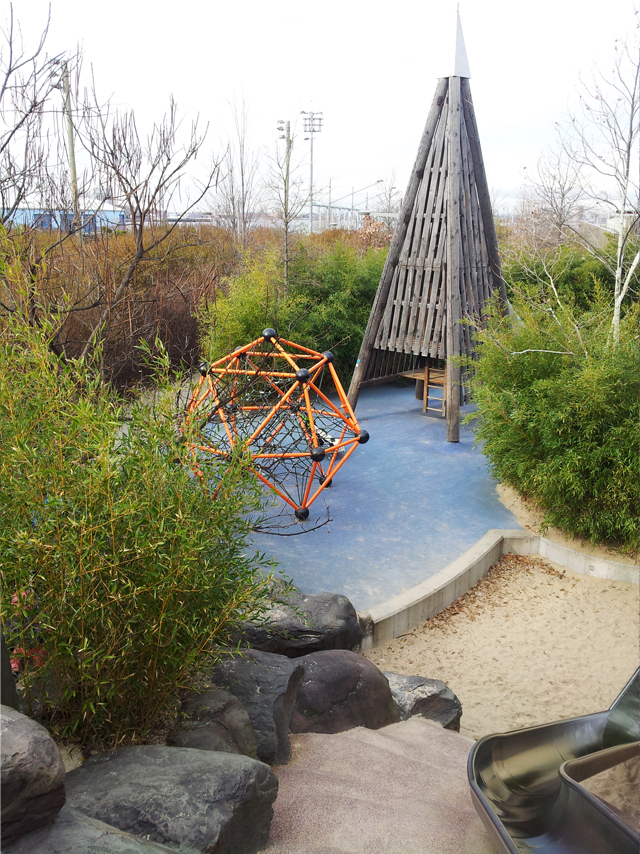 A combination of natural areas and geometric play structures make for endless play possibilities.